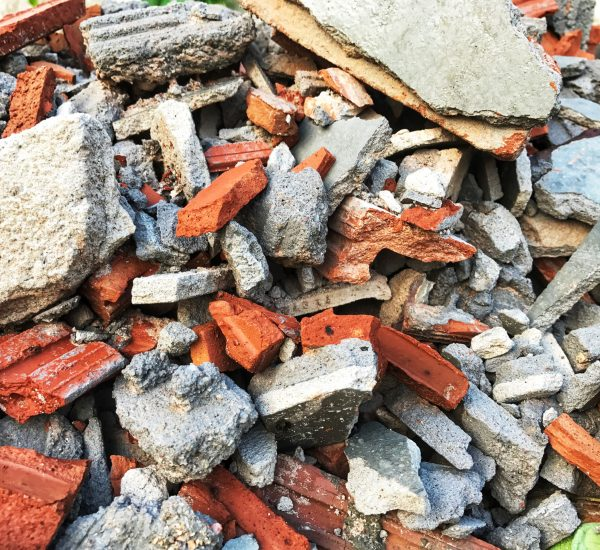 Construction waste of the house ,Orange brick broken remove, home renovation, Scrap of the wall after smash,Stone construction background,texture